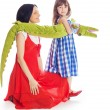 Mom daughter and a toy crocodile — Stock Photo