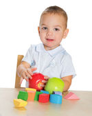 Little boy playing with Montessori materials — Stock Photo