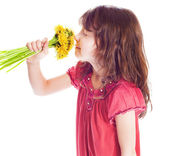Little girl smelling a flower — Stock Photo