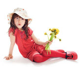 Girl in a hat with flowers — Stock Photo