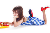 Cute little girl playing in the dollhouse — Stock Photo