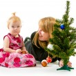 Mom and little daughter a Christmas tree — Stock Photo #37975405