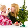Mom and little daughter a Christmas tree — Stock Photo #37975409
