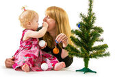 Mom and little daughter a Christmas tree — Stok fotoğraf