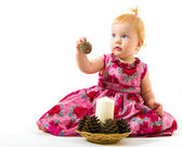 Charming little girl in a Christmas candle in hand with a bump — Stockfoto