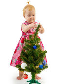 Pretty little girl near the new year tree — Стоковое фото