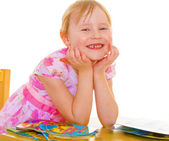 Smiling girl reading the book  — Stock Photo