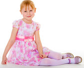 Little girl in a pink elegant dress. — Stock Photo