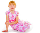 Sits leaning on hand a small charming girl. — Stock Photo