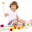 Beautiful little girl in holding a bouquet. — Stock Photo #42504555