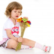 Beautiful little girl in holding a bouquet. — Stock Photo #42504563