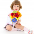 Beautiful little girl in holding a bouquet. — Stock Photo #42504569