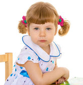 Beautiful little girl with pigtails charming. — Stock Photo