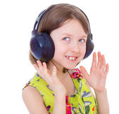 Music little girl in headphones — Stock Photo