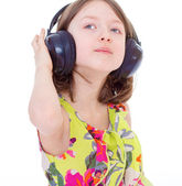 Music little girl in headphones — Stockfoto