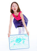 Girl showing her drawing — Stock Photo