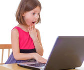Girl at a laptop — Stock Photo