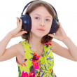 Little girl listening to music. — Stock Photo