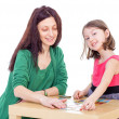 Mom and daughter at the table. — Stock Photo