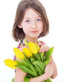Little girl with beautiful flowers. — Stock Photo
