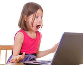 girl sitting at a laptop. — Stock Photo