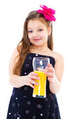 Young girl with glass of orange juice. — Stock Photo