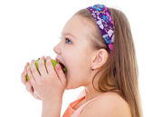 Charming little girl with green apple. — Stock Photo