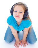 Little child in headphones isolated on white — Stock Photo