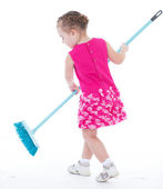 Cute little girl sweeps a floor isolated on white — Stock Photo