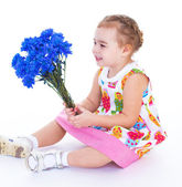 Little girl with blue flowers — Stock Photo