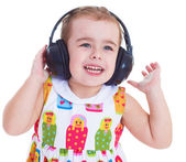 Beautiful cute happy little girl with headphones — Stock fotografie