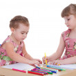 Постер, плакат: Two little girls in kindergarten paint markers while sitting at