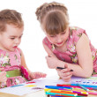 Two little girls in kindergarten paint markers while sitting at — Stock Photo
