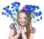 Charming little girl with a bouquet of flowers. — Stock Photo