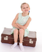 Little girl with a big and very old suitcase. — Stock Photo