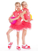 Two young girl gymnast with sports balls. — Stock Photo