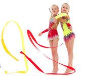Two pretty little girl doing gymnastics — Stock Photo