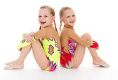 Two pretty little girl doing gymnastics — Stock Photo