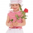Charming little girl with red rose flower — Stock Photo #45259157