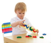 Little boy enthusiastically working with Montessori materials — Stockfoto