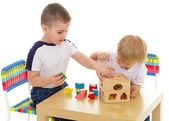 Two boys enthusiastically paint markers — Stock Photo