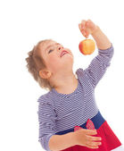 Little girl with apple. — Stock Photo