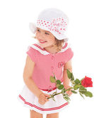 Charming little girl with red rose flower — Stock Photo
