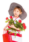 Young girl with hat goes shopping. — Stock Photo