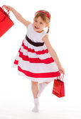 Young girl goes shopping. — Stock Photo