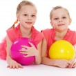 Two charming sisters love to play ball. — Stock Photo