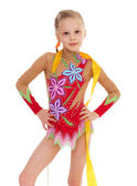 Adorable little gymnast dancing with ribbon — Stock Photo