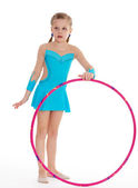 Beautiful little gymnast with the hoop — Stock Photo