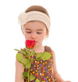 Little girl with a bouquet of red roses .. — Zdjęcie stockowe