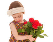 Little girl with a bouquet of red roses .. — Stok fotoğraf